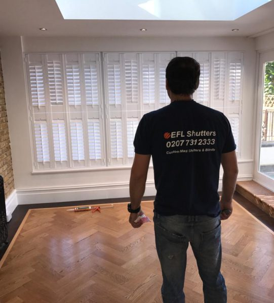 tracked hardwood shutters installed by Efl Shutters