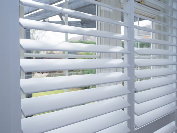 close up of plantation shutters installed in a home in wimbledon