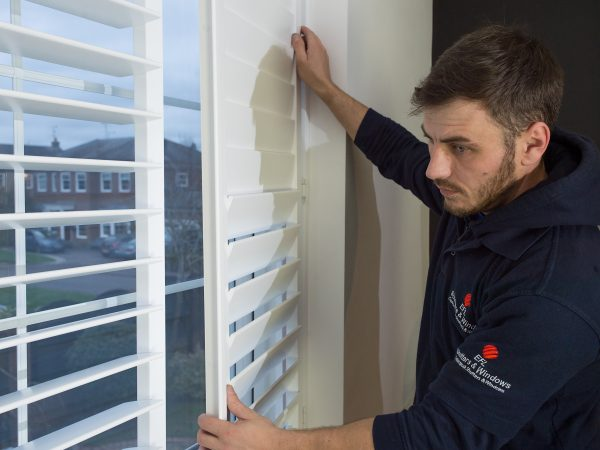 window shutters companies and fitter installing new shutter blinds
